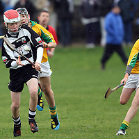 Josh Kelly Cllarecastle U13's about to get his shot away under pressure from Martin Daly Feakle/Killanena. Photograph by Flann Howard