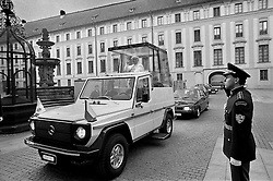 Pope John Paul II drives by in the pope-mobil during his visit in Prague, a few months after the Velvet Revolution in Czechoslovakia