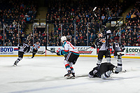 KELOWNA, CANADA - FEBRUARY 16:  Justin Sourdif #42 of the Vancouver Giants collides with a teammate after a check on Alex Swetlikoff #17 of the Kelowna Rockets during first period on February 16, 2019 at Prospera Place in Kelowna, British Columbia, Canada.  (Photo by Marissa Baecker/Shoot the Breeze)