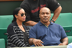 Former heavyweight boxing world champion Mike Tyson (C) and his wife Lakiha Spicer attend the 2018 French Open - Day T'en at Roland Garros on June 5, 2018 in Paris, France. Photo by Laurent Zabulon/ABACAPRESS.COM