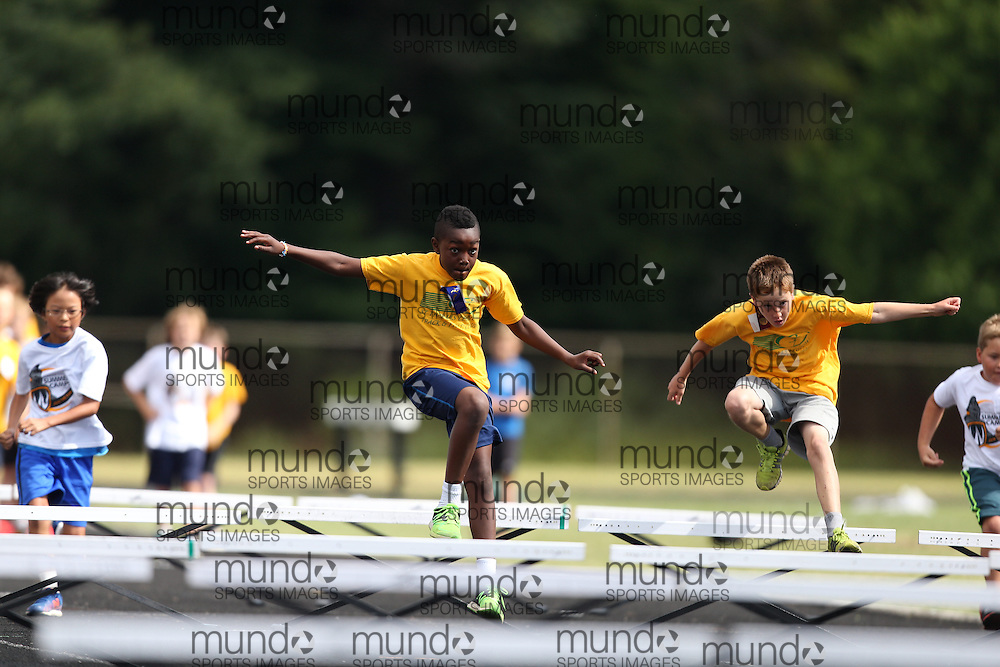 Athletes from St Thomas Legion Track and Field Club summer camp compete in the club's rugrats meet at Parkside Collegiate in St. Thomas, Ontario, August 6, 2015.<br /> Mundo Sport Images PHOTO/Geoff Robins