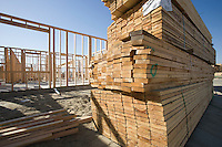 House construction and stack of planks