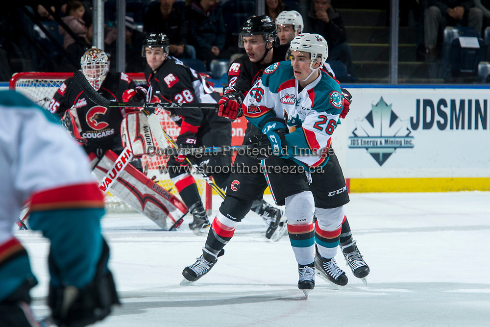 KELOWNA, CANADA - FEBRUARY 20:  Cole Moberg #2 of the Prince George Cougars back checks Liam Kindree #26 of the Kelowna Rockets during first period on February 20, 2018 at Prospera Place in Kelowna, British Columbia, Canada.  (Photo by Marissa Baecker/Shoot the Breeze)  *** Local Caption ***