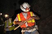 Mining engineering student, Marks Yups, trains with blasting powder at the San Xavier Mining Laboratory Training Center, University of Arizona, Tucson, USA.