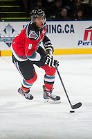 KELOWNA, CANADA - OCTOBER 11: Madison Bowey #4 of Kelowna Rockets skates with the puck against the Lethbridge Hurricanes on October 11, 2014 at Prospera Place in Kelowna, British Columbia, Canada.   (Photo by Marissa Baecker/Shoot the Breeze)  *** Local Caption *** Madison Bowey;