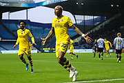 Swansea City forward Andre Ayew (22) celebrates after scoring his team's first goal during the EFL Sky Bet Championship match between Sheffield Wednesday and Swansea City at Hillsborough, Sheffield, England on 9 November 2019.
