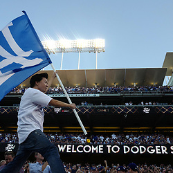 Actor Ken Jeong waves Dodger flag prior to game one of a World Series baseball game between the Houston Astros and the Los Angeles Dodgers at Dodger Stadium on Tuesday, Oct. 24, 2017 in Los Angeles. (Photo by Keith Birmingham, Pasadena Star-News/SCNG)