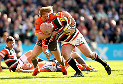 Dan Cole of Leicester Tigers is tackled by Joel Hodgson of Newcastle Falcons - Mandatory by-line: Robbie Stephenson/JMP - 15/04/2017 - RUGBY - Welford Road - Leicester, England - Leicester Tigers v Newcastle Falcons - Aviva Premiership