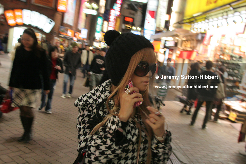 Street scene with young woman, in Shibuya district of Tokyo, Japan, on Saturday, Nov. 18, 2006.