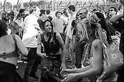Women with dreadlocks dancing, Reclaim the Streets, Shepherd's Bush, London, July 1996