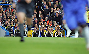 Guus Hiddink and his assistant Ray Wilkins watch from the bench during the UEFA Champions League Semi Final Second Leg match between Chelsea and Barcelona at Stamford Bridge on May 6, 2009 in London, England.