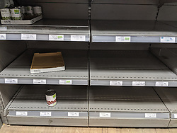 In a Waitrose supermarket in Clapham, London, the canned beans section is left empty by panic buyers during the beginning of the COID-19 crisis.