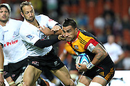 Chiefs' Liam Messam charges against Sharks' Stefan Terblanche. Super 15 rugby union match, Chiefs v Sharks at Waikato Stadium, Hamilton, New Zealand. Friday 18th March 2011. Photo: Anthony Au-Yeung / photosport.co.nz
