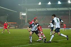 WREXHAM, WALES - Wednesday, February 9, 2011: Wales' Jonathan Williams is fouled by Northern Ireland's Seanan Clucas for a penalty during the Under-21 International Friendly match at the Racecourse Ground. (Photo by David Rawcliffe/Propaganda)
