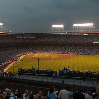Photo of Wrigley Field Chicago Cubs game at night. Located in Wrigleyville, Wrigley Field was built in 1914 and is one of the oldest active ballparks in the United States.