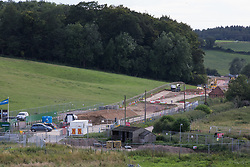 Chalfont St Giles, UK. 18th July, 2020. A temporary haul road is prepared for use in the construction of a ventilation shaft for the Chiltern Tunnel on the HS2 high-speed rail link. The Department for Transport approved the issuing of Notices to Proceed by HS2 Ltd to the four Main Works Civils Contractors (MWCC) working on the £106bn rail project in April 2020.