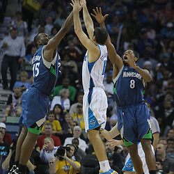 08 February 2009: New Orleans Hornets forward Peja Stojakovic (16) shoots over Minnesota Timberwolves defender Al Jefferson (25) and Ryan Gomes (8) during a 101-97 win by the New Orleans Hornets over the Minnesota Timberwolves at the New Orleans Arena in New Orleans, LA.
