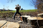 Student Ian Miller chops wood that will be used over the winter to heat the Mountain School