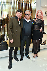 Left to right, ROBBIE FURZE, GIUSEPPE ZANOTTI and LADY MARY CHARTERIS at the launch of the new Giusepe Zanotti store in Conduit Street, London on 26th October 2016.