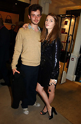ASHLEY FLETCHER and Model BEN GRIMES at a party to celebrate the 10th anniversary of the Smythson Fashion Diary and to the launch of the 2007 Limited Edition held at Smythson, New Bond Street, London on 25th October 2006.<br />