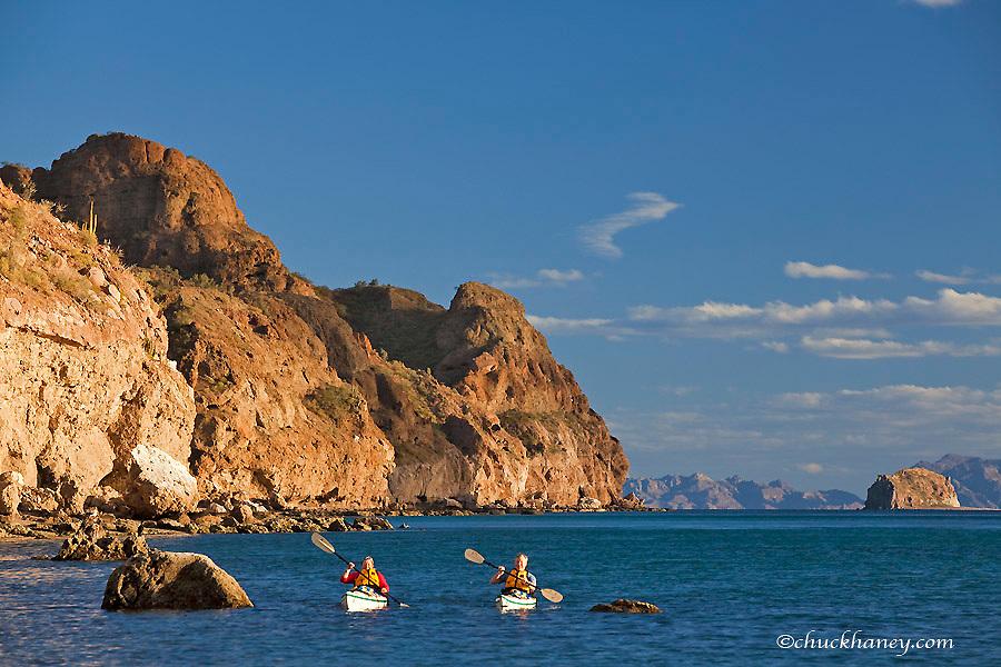 Sea kayakers on the Gulf of California at Isla Danzante near Loreto Mexico model released