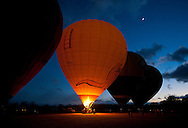 Crews prepare hot air balloons for a sun rise flight north of Cairns.