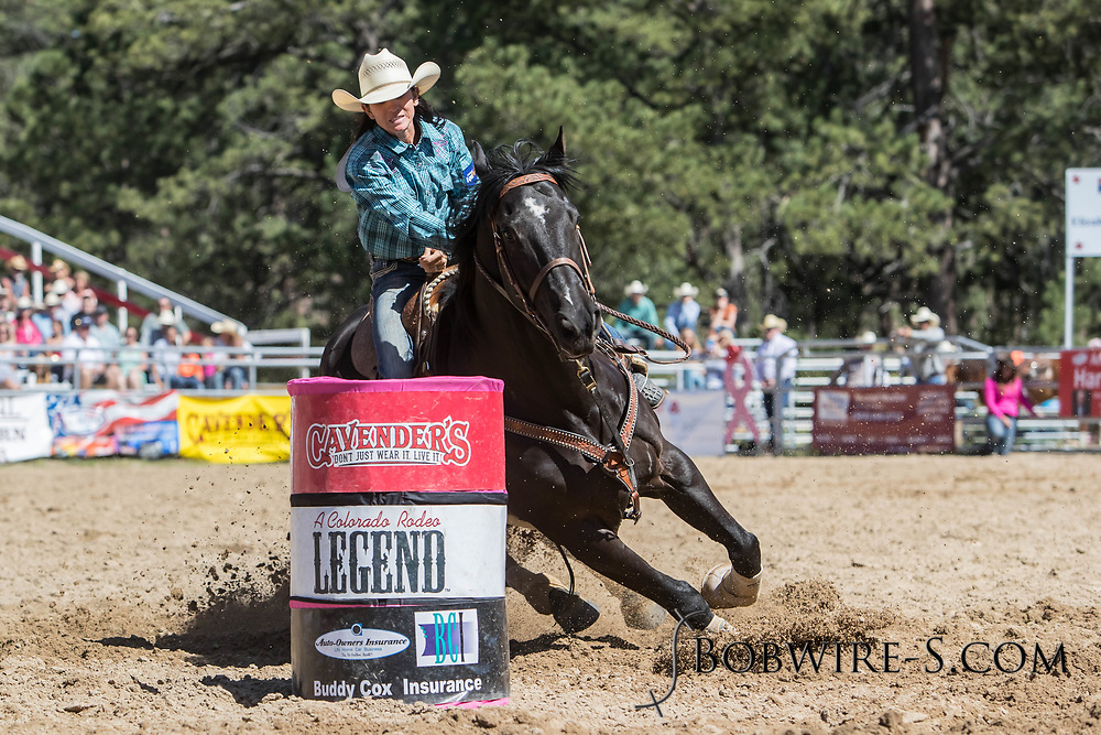 Heather Colletti makes her barrel racing run in the first performance of the Elizabeth Stampede on Saturday, June 2, 2018.