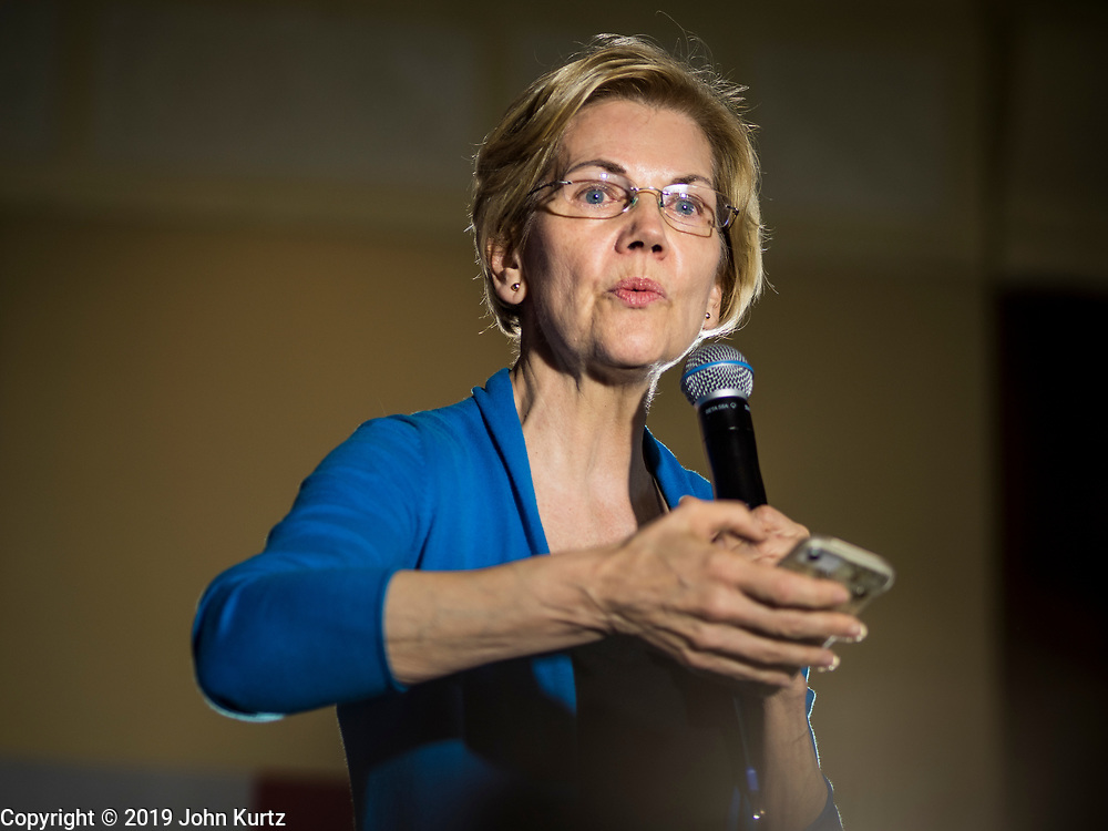 03 MAY 2019 - AMES, IOWA: Sen. ELIZABETH WARREN (D-MA) used a cellphone to talk about her plan to reduce student debt during her campaign appearance at Iowa State University in Ames. About 400 people attended the event. Sen. Warren is campaigning in Iowa Friday and Saturday to promote her bid to be the Democratic candidate for the US Presidency. Iowa traditionally hosts the the first selection event of the presidential election cycle. The Iowa Caucuses will be on Feb. 3, 2020.              PHOTO BY JACK KURTZ