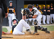 Mike Rizzo, of Evergreen Park, holds on to the ball for the out after a collision at the plate with Richards' Nick Mejia. Monday, April 6th, 2015, in Oak Lawn. (Gary Middendorf/ For the Daily Southtown)