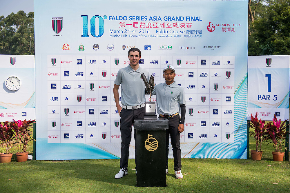 M. Afif Mohd Fathi of Malaysia and Harry Goddard of England poses for a picture with the trophy during day one of the 10th Faldo Series Asia Grand Final at Faldo course in Shenzhen, China. Photo by Xaume Olleros.