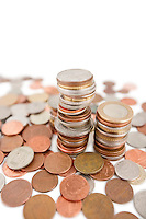Close-up of heap of coins over white background
