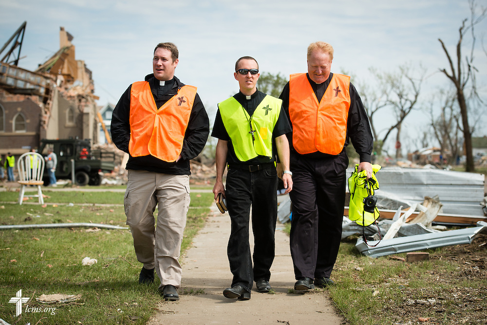 (L-R) The Rev. Michael Meyer, manager of LCMS Disaster Response, the Rev. Brian Bucklew, pastor at Zion Lutheran Church, and the Rev. L. Scott Spiehs, pastor of St. John's Lutheran Church and South Dakota District Response Coordinator, walk the neighborhood around  Zion Lutheran Church (seen in the rear left) on Tuesday, May 12, 2015, in Delmont, S.D. A tornado swept through the area on Sunday and destroyed the church along with nearby buildings. LCMS Communications/Erik M. Lunsford