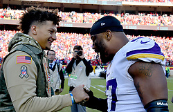 Nov 3, 2019; Kansas City, MO, USA; Kansas City Chiefs quarterback Patrick Mahomes (15) talks with Minnesota Vikings defensive end Everson Griffen (97) after the game at Arrowhead Stadium. Mandatory Credit: Denny Medley-USA TODAY Sports