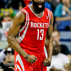 Jan 25, 2013; New Orleans, LA, USA; Houston Rockets shooting guard James Harden (13) reacts after a basket against the New Orleans Hornets during the first quarter of a game at the New Orleans Arena. Mandatory Credit: Derick E. Hingle-USA TODAY Sports