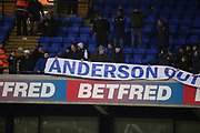 Bolton Wanderers fans keep the protest banner against the chairman out of reach of stewards during the EFL Sky Bet Championship match between Bolton Wanderers and West Bromwich Albion at the Macron Stadium, Bolton, England on 21 January 2019.