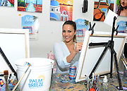 Reality TV dating star Andi Dorfman gets in touch with her creative side at her housewarming event at the Painting Lounge hosted by Palm Breeze, a new tropical sparkling alcohol spritz from Mike's Hard Lemonade Co., Thursday, Aug. 6, 2015 in New York. (Diane Bondareff/AP Images for Palm Breeze)