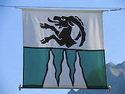 The flag of Lauterbrunnen commune (located in Bern canton, Switzerland, the Alps, Europe) has an ibex and three wavy white triangles on a green background symbolizing the three famous local waterfalls (including Staubbach Falls, or Staubbachfall in German, the highest watefall in Switzerland).