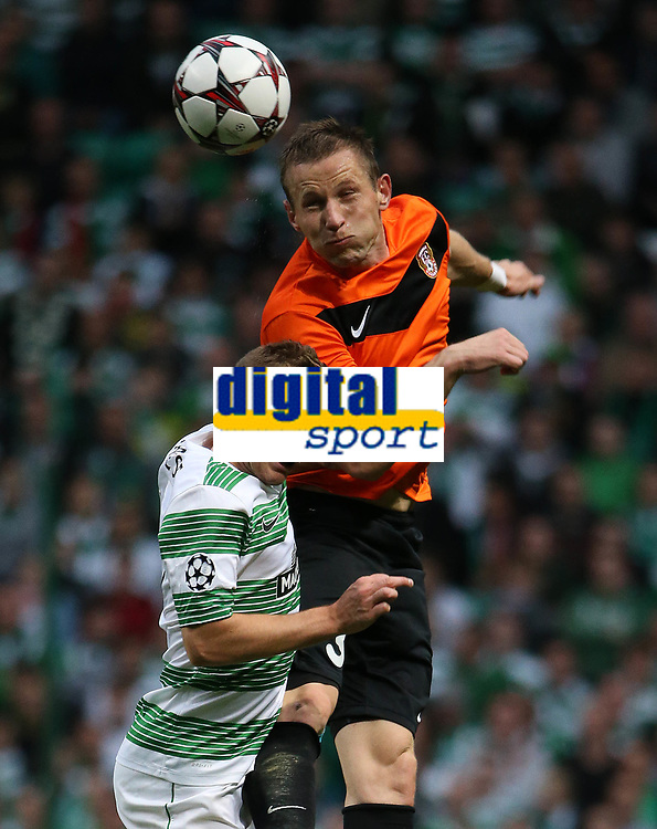 Football - 2013 / 2014 Champions League - Qualifying, Play-Off Round, Second Leg: Celtic vs. Shakhter Karagandy<br /> <br /> James Forrest of Celic vies with Gediminas Vicius of Shakhter during the Celtic and Shakhter Karagandy Champions League qualification match at Parkhead Stadium, Glasgow on August 28th August 2013.<br /> <br /> Ian MacNicol/Colorsport
