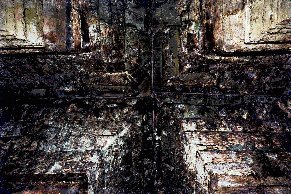 Angkor Wat : corner corbelled cross vault, looking up, with the lines, textures, and colors of the masonry emphasized to create a symmetrical, central composition held together by the cross formation at the peak of the vault.