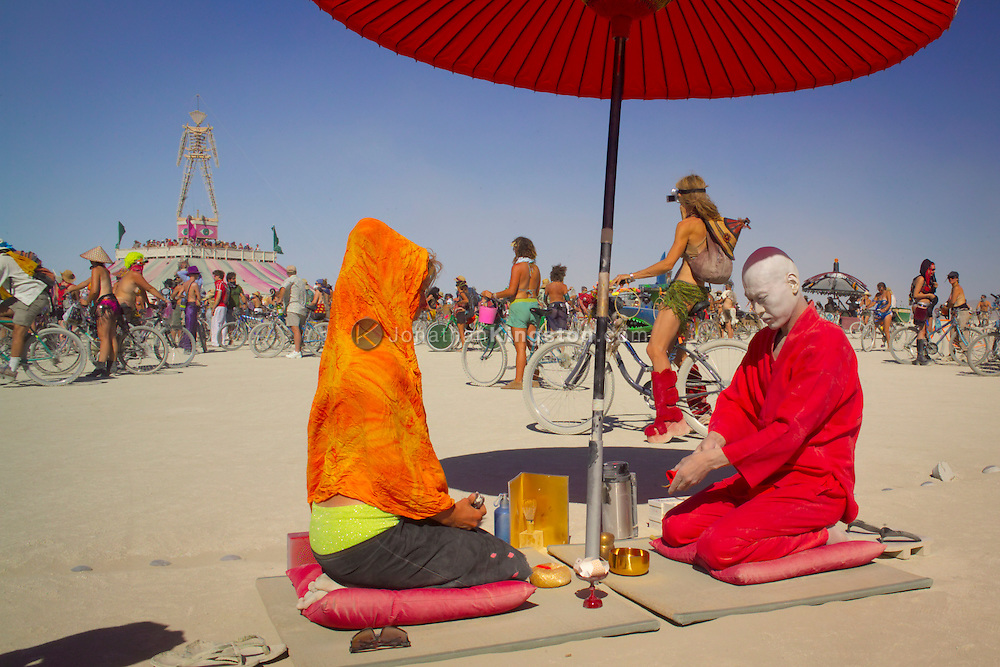 BLACK ROCK CITY, NV:  Participants of Burning Man festival partake in a Japanese tea ceremony in front of the fun house in Black Rock City, Nevada.