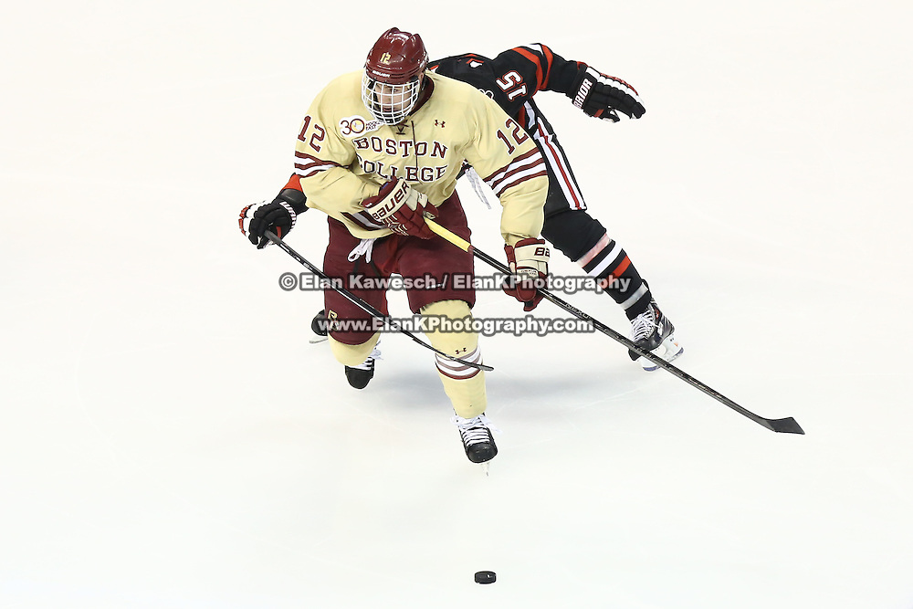 Kevin Hayes #12 of the Boston College Eagles keeps the puck from Kevin Roy #15 of the Northeastern Huskies during The Beanpot Championship Game at TD Garden on February 10, 2014 in Boston, Massachusetts. (Photo by Elan Kawesch)