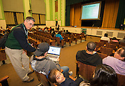 Counselor Alfredo Vila shows a laptop to parents during a Spanish language session PowerUp meeting at Austin High School, November 7, 2013.