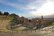 Greek Theatre, built 3rd century BC, in Taormina, Messina, Sicily, Italy. Although originally and typically Greek, used for theatre and music performances, the theatre was remodelled in the 2nd century AD by the Romans and used for games and gladiatorial contests. Picture by Manuel Cohen