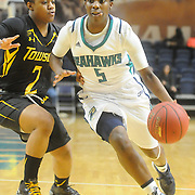 UNCW's Shatia Cole drives on Towson's Breonn Hughey Sunday January 25, 2015 at Trask Coliseum. (Jason A. Frizzelle)