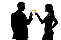 one caucasian couple man and woman drinking champagne toasting partying in studio silhouette isolated on white background