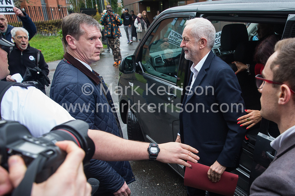 London, UK. 26 November, 2019. Labour Party leader Jeremy Corbyn arrives at the Bernie Grant Arts Centre in Tottenham to launch Labour's new Race and Faith Manifesto amid a small protest by Campaign Against Antisemitism activists.