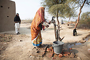 A Hindu women, rescued from slavery, pumps water at her new village home. Following the release of the Global Slavery Index by the Walk Free Foundation Pakistan is ranked 3rd worse in the world behind India and China. The Asian Development Bank estimates some 1.8 million people are slaves in Pakistan yet other estimates reach up to 4 million people, most of which toil year after year in brick kilns or sugar cane plantations. Their stories are the same; they have no-where to turn so they borrow money from a land-owner for a medical emergency or marriage dowry. The landlords pay in return for work, their labour supposed to be taken off the amount borrowed. Yet after years of no salary incredibly their amount owed is often quadrupled, the excuse being the amount they cost to feed! Many are chained, abused, raped and even killed.<br /> <br /> For years they had no where to run, no one to help but now a small local NGO called the Green Development Rural Organisation (GDRO) works to free bonded-slaves by using the law against their captives. Yet, often freed slaves end up right back where they were or risk being hunted by the landowner and forced to return. So GRDO started building villages so slaves who escape or are freed have somewhere safe to go. It now has two, whose names translate from Urdu as 'Village of the Freed' and 'Village of the Courageous', and is working on a 3rd. The land is bought and allocated to freed slave families where they can built a house and start again. Without such help the vicious cycle would continue.