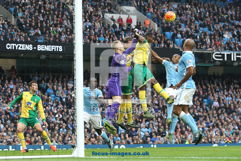Ryan Bennett of Norwich and Sebastien Bassong of Norwich put Joe Hart of Manchester City under pressure during the Barclays Premier League match at the Etihad Stadium, Manchester<br /> Picture by Paul Chesterton/Focus Images Ltd +44 7904 640267<br /> 31/10/2015