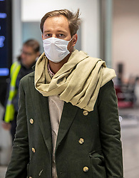 © Licensed to London News Pictures. 29/01/2020. London, UK. Passengers arrive at London Heathrow Terminal 5 with marks on as the last BA flight from China arrives. The coronavirus virus has infected more than 40000 people across Asia in the past few weeks. Photo credit: Alex Lentati/LNP