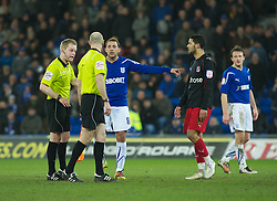 CARDIFF, WALES - Tuesday, February 1, 2011: Cardiff City's Michael Chopra and Reading's Jobi McAnuff are spoken to by Referee Gavin Ward during the Football League Championship match at the Cardiff City Stadium. (Photo by Gareth Davies/Propaganda)